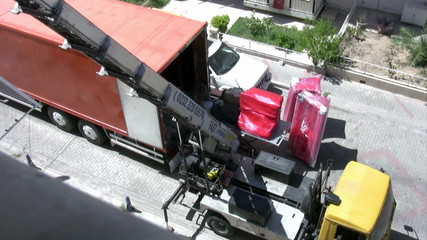 Moving truck in a house driveway