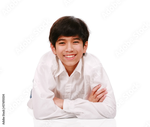 Handsome biracial teen boy smiling, lying down