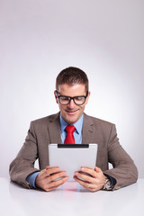young business man reading from tablet