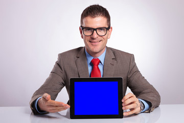 young business man presents his tablet
