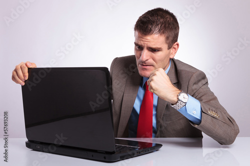 young business man wants to punch laptop