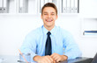Young laughing businessman in office