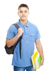 smiling student with books and backpack