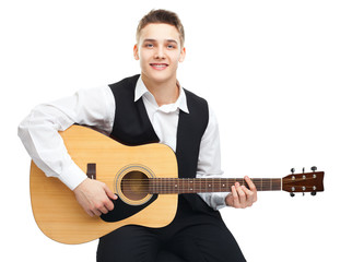 Young man playing on guitar