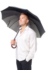 Happy young man under an umbrella