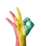 Hand making Ok sign, Guinea flag painted
