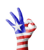 Hand making Ok sign, Liberia flag painted