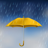 Yellow umbrella in rain