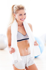 Woman with towel at gym