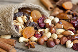 Fototapety Nuts and dried fruits mixed assortment of delicacies