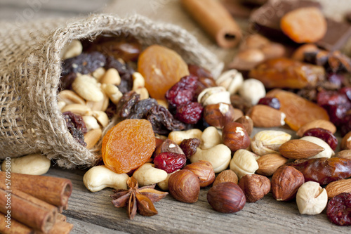Nuts and dried fruits mixed assortment of delicacies - 57695880