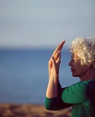 Senior caucasian woman exercising by the sea