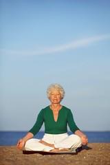 Senior woman practicing morning yoga