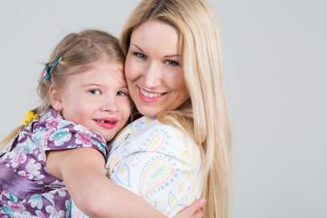 Tender portrait of mother and daughter hugging
