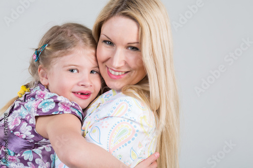 Tender portrait of mother and daughter hugging