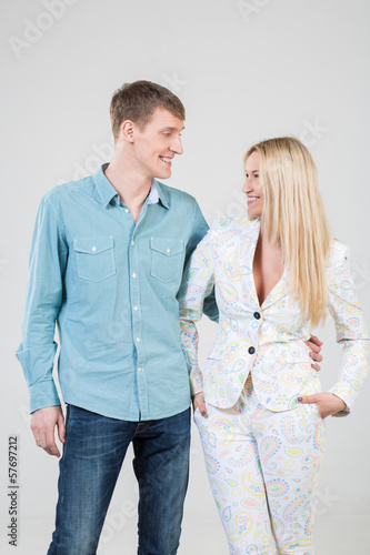 girl and smiling boy in shirt looking at each other