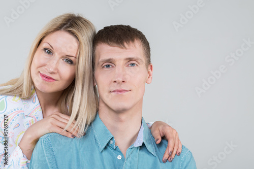 Portrait of a beautiful young couple in studio