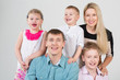 Happy smiling family of five people in the studio
