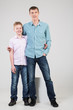 Father and son are standing in an embrace in jeans