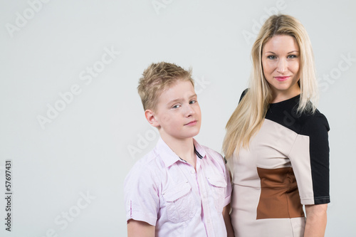 Mother with blond hair and a son with disheveled hair