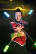 man with tattoo in samurai garb with glow sticks