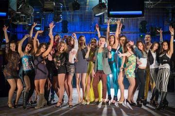young people having fun and dancing on dancefloor