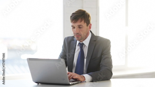 businessman working with laptop computer