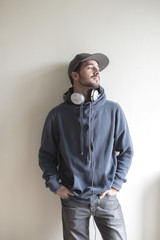 young stylish man listening to music