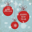 blue retro christmas card with falling snowflakes and red balls
