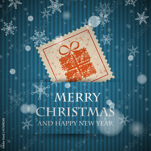 blue stamp christmas card with falling snowflakes