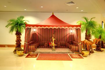 Lobby interior of the luxury hotel in night illumination, Ajman,