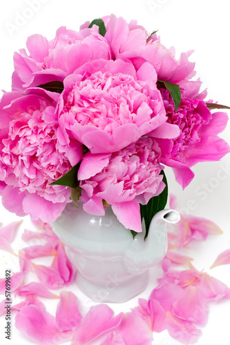 Bunch of peonies in vase isolated on white