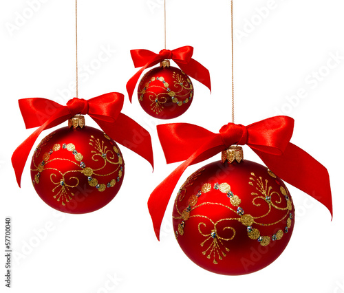 Red christmas balls with ribbon isolated on a white