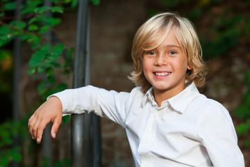 Cute blond boy outdoors.