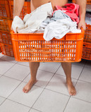 Semi Nude Man Carrying Basket In Laundry