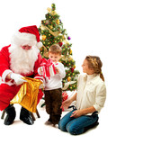 Santa Claus giving Christmas Gifts to Children. Christmas Scene