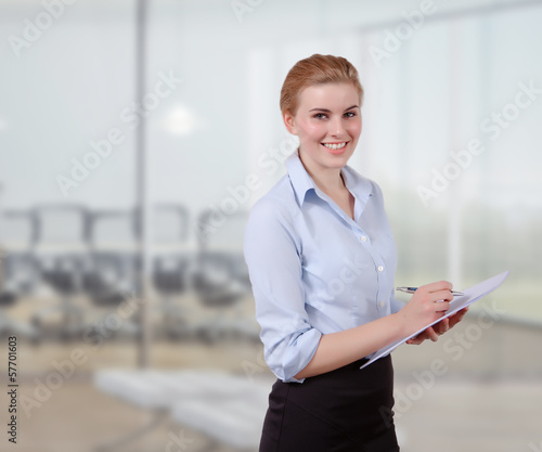 Young Businesswoman with Folio