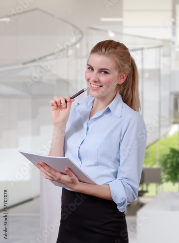 Businesswoman organizing document