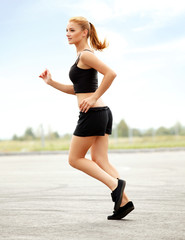 Athletic Runner Training in a park for Marathon. Fitness Girl