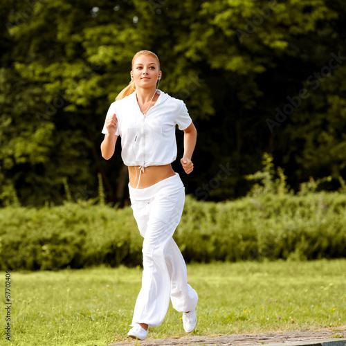 Athletic Runner Training in a park for Marathon. Fitness Gir