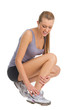Sport woman feeling pain in her ankle.
