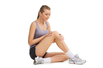 Nice blond girl feeling pain in her knee.