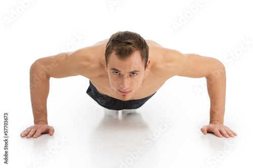 fitness man exercising push ups smiling happy.
