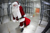 last  Santa Claus loosing gifts from sack in empty storehouse