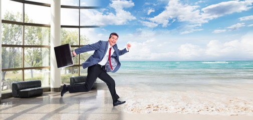 Happy Man running on the beach.