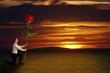 Mann hält eine Rose vor Sonnenuntergang