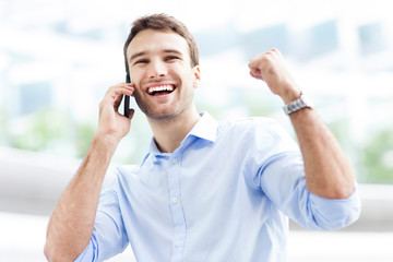 Excited man with mobile phone