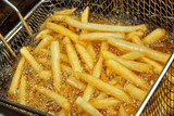 French fries in a deep fryer closeup
