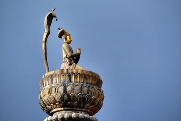 King Yoganarendra Malla bronze statue on a column. Nepal
