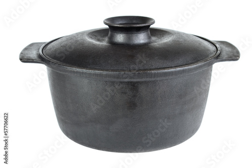 Old cast iron cooking pot , isolated on white